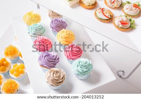 Dessert bar with assorted cup cake sweets  - stock photo
