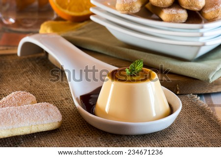 dessert called creme caramel on white cup - stock photo