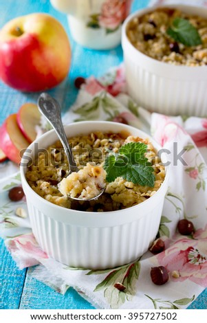 Dessert crumble with apple and nuts in a rustic style