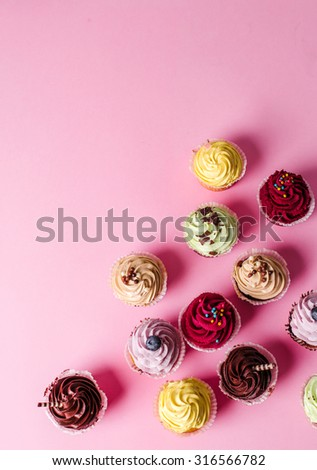 Dessert. Delicious cupcake on the table - stock photo