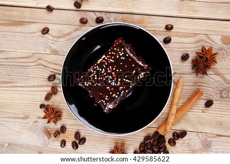 dessert : hot black coffee and chocolate cake with cinnamon , coffee beans, and anise star - stock photo