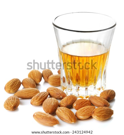 Dessert liqueur Amaretto with almond nuts, isolated on white - stock photo