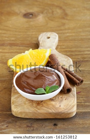 dessert of chocolate mousse (melted chocolate) with orange - stock photo
