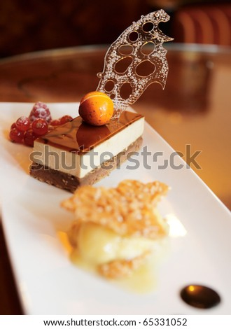 Dessert on restaurant table, shallow focus depth - stock photo
