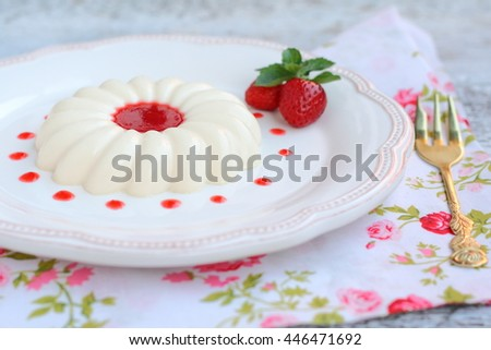 Dessert panna cotta with strawberry sauce in a pot in the style of a romantic - stock photo