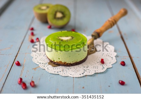 Dessert souffle with kiwi on a wooden background - stock photo