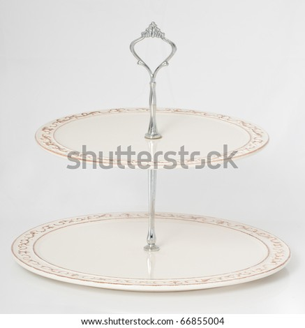 Dessert stand on a seamless white background