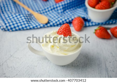 Dessert strawberries with whipped cream in a cup - stock photo