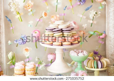 Dessert table with a macaroons composition - colorful pyramid. - stock photo