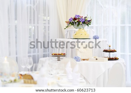 Dessert table with a wedding cake - stock photo