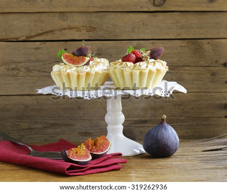 dessert tartlets from shortcrust pastry with meringue and fruit - stock photo