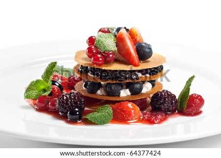 Dessert with Berries and Fresh Mint - stock photo