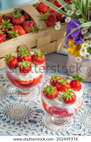 Dessert with strawberries and cream - stock photo