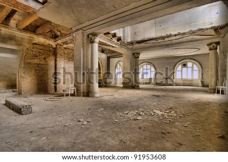 Destroyed and abandoned interior with columns - stock photo