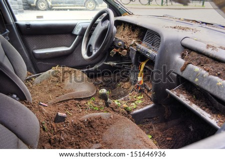 Destroyed and ruined car. Impacts of vandalism  - stock photo