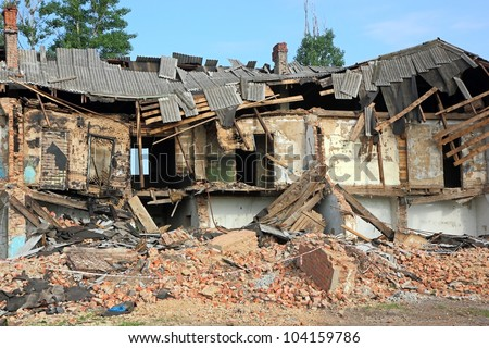 Destroyed building, can be used as demolition, earthquake, bomb, terrorist attack or natural disaster concept. - stock photo