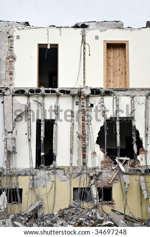 Destroyed building, can be used as demolition, earthquake, bomb, terrorist attack or natural disaster concept. Series - stock photo