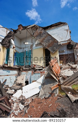 Destroyed building, can be used as demolition, earthquake, bomb, terrorist attack or natural disaster. - stock photo