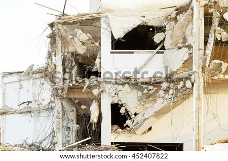 Destroyed building,pile of bricks and concrete. - stock photo