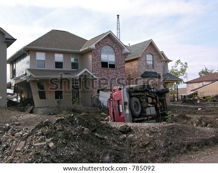 destroyed home and overturned SUV about 100 ft. from the 17th Street Canal levee breach that flooded New Orleans after Hurricane Katrina - stock photo