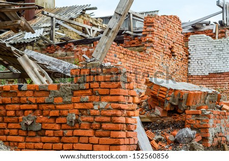 Destroyed industrial building constructed of red bricks on crisis time - stock photo