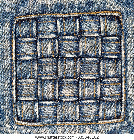 Destroyed torn denim blue jeans wicker patch,  Close up - stock photo