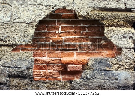 destroyed wall with a brick - stock photo