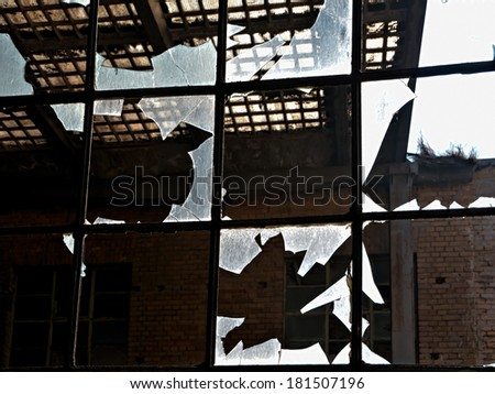 destroyed windows of a factory - stock photo