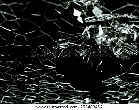 Destructed or broken glass pieces on black background. shallow DOF - stock photo