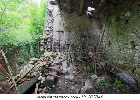 destruction of an old abandoned house collapsed after the earthquake - stock photo