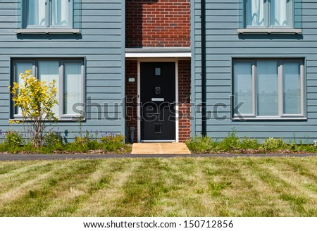 detached british residential house (beach style) with garden - stock photo