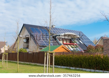 detached house in germany with solar panels on its roof - stock photo