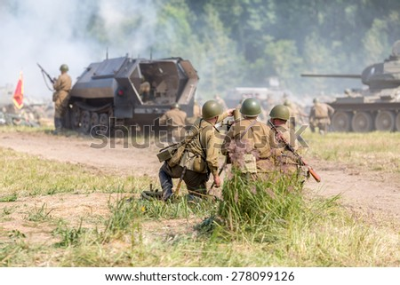 detachment of the three Soviet soldiers firing mortar - stock photo