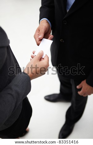 Detail businessman and woman exchanging cards - stock photo