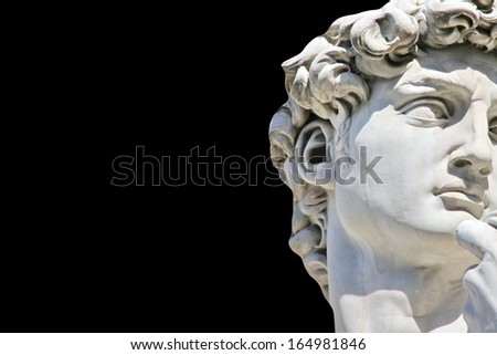 Detail close-up of Michelangelo's David statue on black background, with place for your design or text