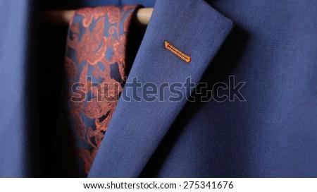 Detail closeup close-up of suit jacket lapel button hole fabric - stock photo