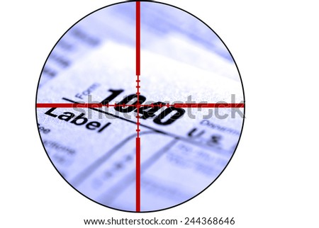 Detail closeup of current tax forms for IRS filing with crosshairs to destroy taxes - stock photo