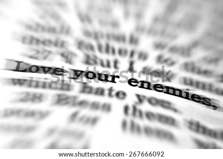 Detail closeup of New Testament Scripture quote Love Your Enemies - stock photo