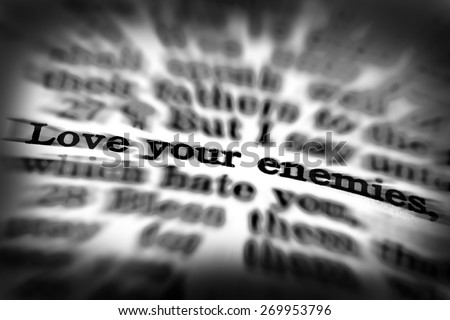 Detail closeup of Scripture quote Love Your Enemies - stock photo