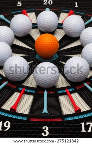 Detail dartboard with different golf balls - stock photo