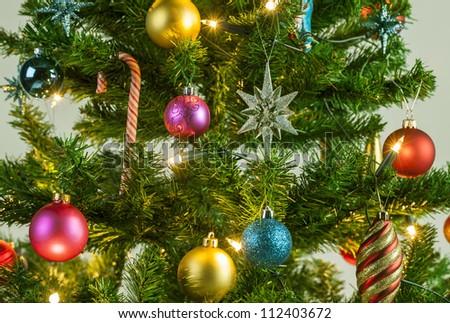 Detail from a beautiful illuminated christmas tree - stock photo