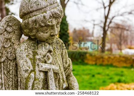 Detail from cemetery art, portrait of a sad angel. - stock photo