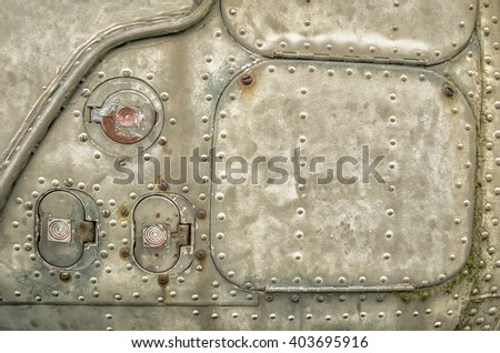 Detail from old war plane as background - stock photo