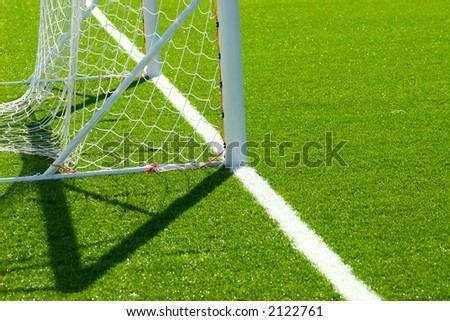 Detail from soccer/football pitch, goal on artificial grass - stock photo