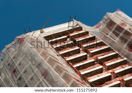 detail from the top of a building under construction in downtown sao paulo - stock photo