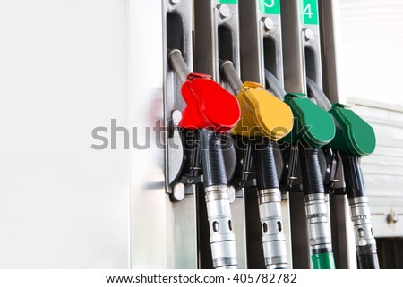 Detail fuel pump at auto gas station, close up, copy space - stock photo