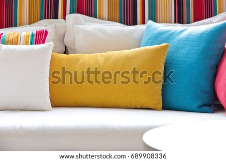 detail image of colorful cushion on sofa, living room, modern house, home decoration