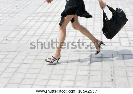 detail in blur of  woman legs running on the pavment - stock photo