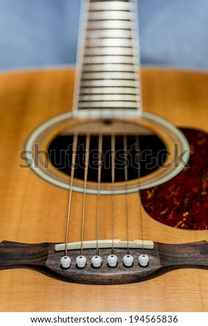 detail of a acoustic guitar, shallow depth of field - stock photo