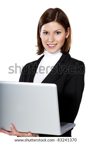 Detail of a beautiful young businesswoman holding an open laptop